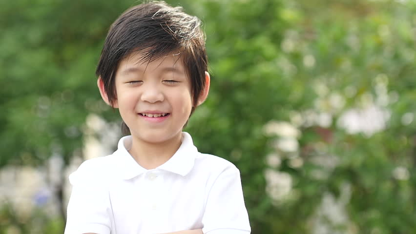 Close up of asian child yawning outdoors slow motion | Shutterstock HD Video #30023056