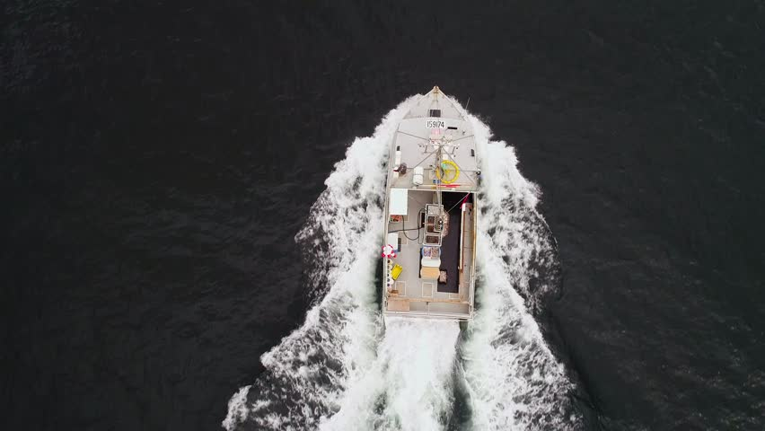 A cool aerial shot of professional fishermen catching lobster on theri boat off the coast