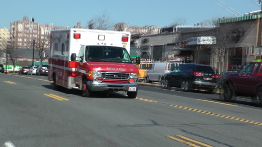 WASHINGTON, DC - CIRCA FEB. 2012: Fire Department Fire EMS races past street, siren blaring, responding to a call. EMS is part of the Fire  Department in Washington - DC FEMS.