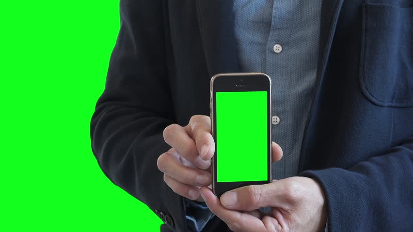Businessman Holding Green Screen Smartphone. Man holding a smartphone with green screen in vertical position for background replacement. #30056056