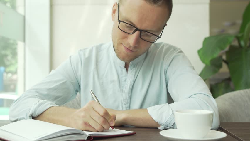 Businessman writing a to do list in a business planner | Shutterstock HD Video #30056806