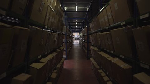 steadicam Footage Forklift Trucks Loads In The Rack Inside logistic warehouse