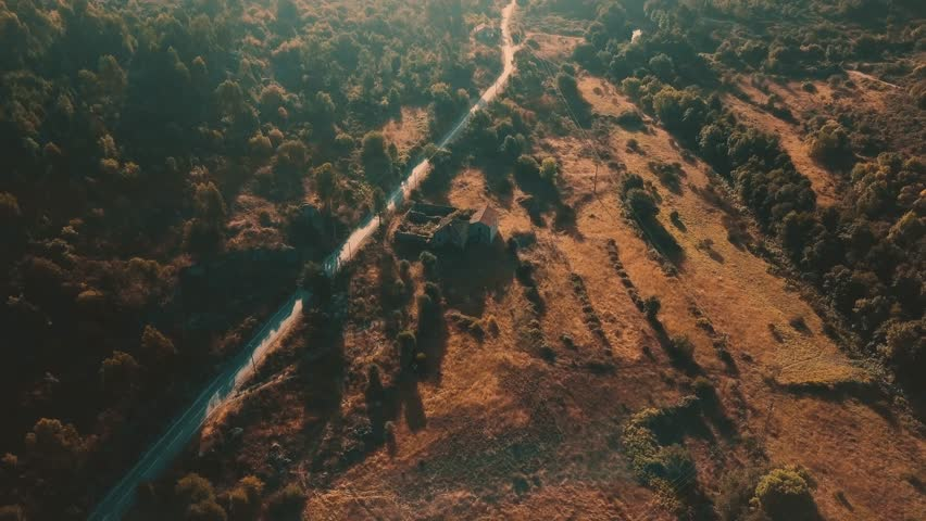 Cinematic Aerial View of an abandoned house during Sunrise in a rural area of South Europe, Beautiful Nature Landscape of Northern Portugal in 4K