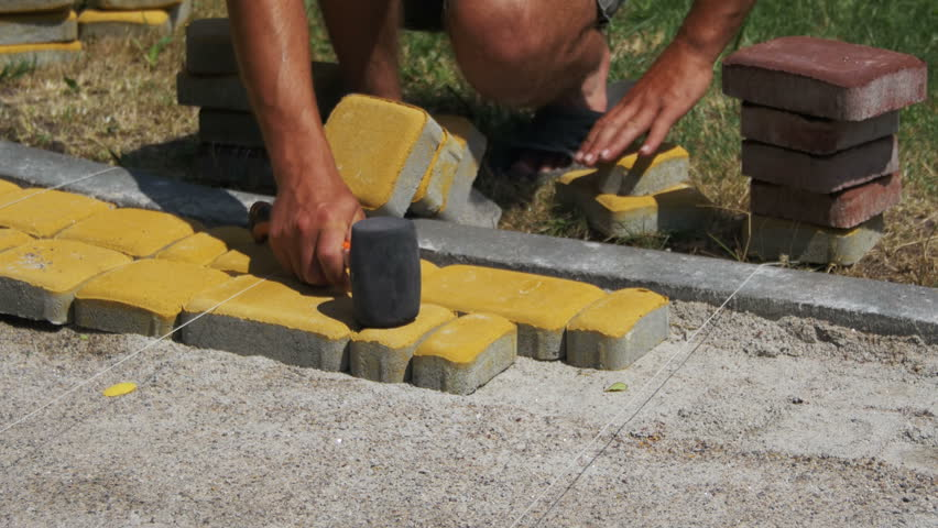 The Builder is Laying Paving Stock Footage Video (100% Royalty-free)  30070396 | Shutterstock