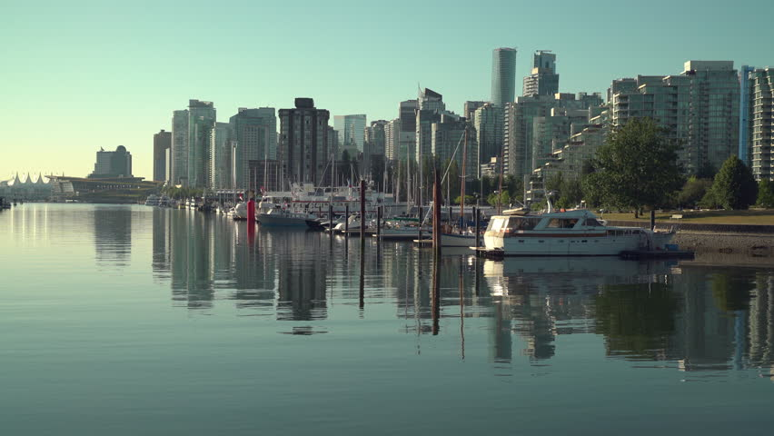 Coal Harbor, Vancouver Cityscape 4K UHD. Early morning on the Stanley Park Seawall by Coal Harbor. British Columbia, Canada.