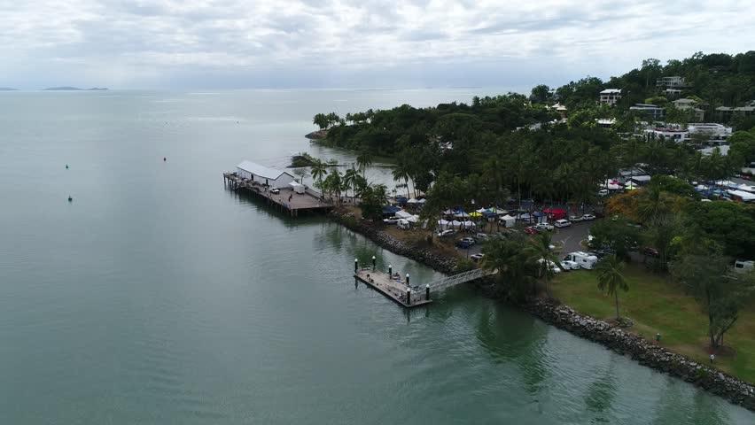 4K Aerial Footage coastal town - Port Douglas Queensland Australia - side spin pan