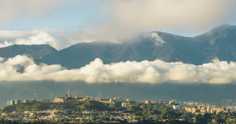 Panning view of  business district in eastern Caracas city Valley.  . Located at the north the majestic view of El Avila mountain (Cerro El Avila) with a height of 2100 mt over sea level.
