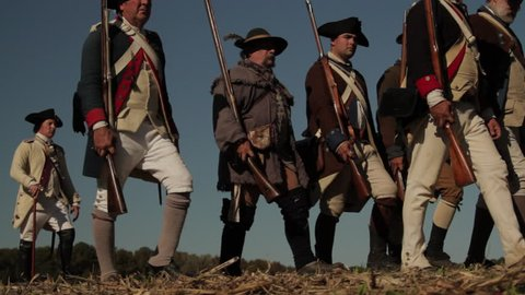 VIRGINIA - OCTOBER 2016 - Reenactment, large-scale, epic American Revolutionary War anniversary recreation --  Pre-Napoleon French Army Soldiers in formation marching as on parade with Muskets, flags.