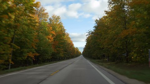 Driving POV in Autumn on a straight section of M-123 (Michigan state route 123) in Luce County, Upper Peninsula, Michigan.