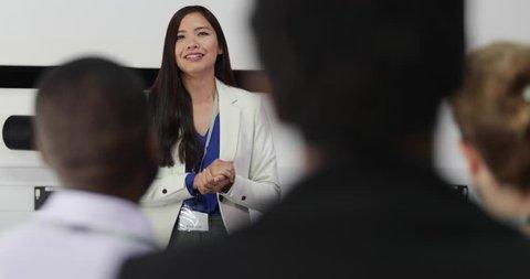 Female executive leading a training conference