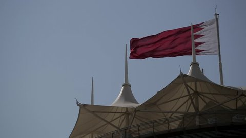 National flag of the Kingdom of Bahrain waving in the wind.