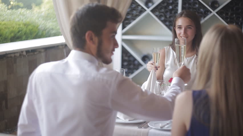 Company of young people is chatting and smiling in the bar | Shutterstock HD Video #30252826
