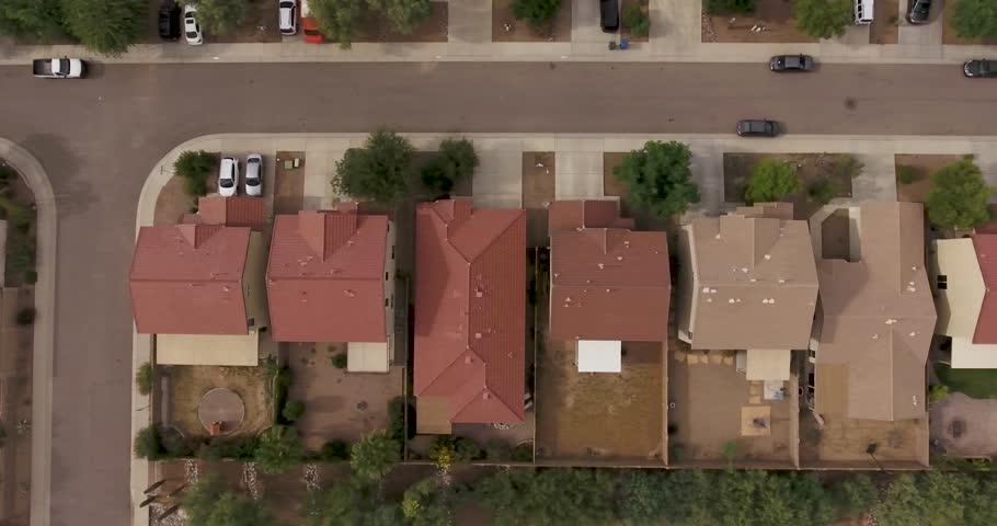 Flying above a generic suburban neighborhood.