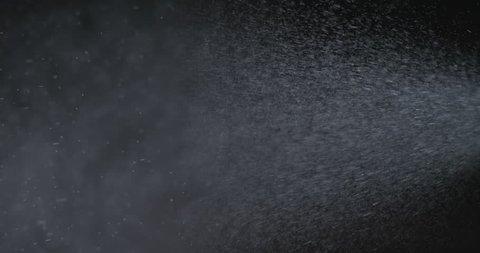 Water spray against black background shot at 1000fps. Shot on Phantom flex 4k.