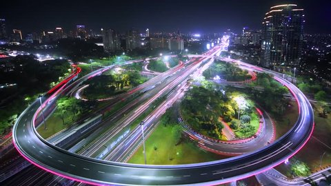 4K Time lapse footage of Jakarta Central Business District and Semanggi interchange with fast moving cars at night.