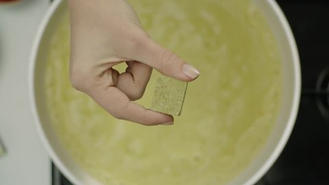 Cooking with bouillon. Top angle and hand. High quality and super slow