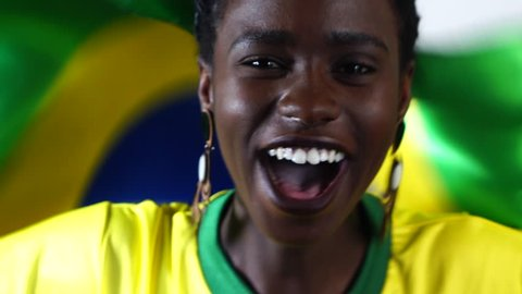 Brazilian Young Black Woman Celebrating with Brazil Flag