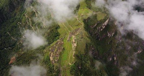Machu Picchu Peru Aerial v2 Birdseye view flying over ancient ruins