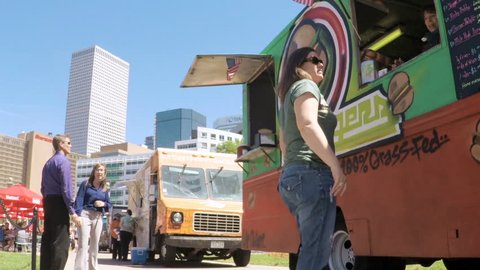 Denver, Colorado, USA-June 15, 2017.  POV point of view - Lunch time gathering of gourmet food trucks at the Civic Center Park.