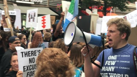 NEW YORK - SEPT 2, 2017: man with bullhorn speaking at animal rights march with signs NYC 4K. Vegans and other animal rights activists gathered to march through the city protesting animal oppression.