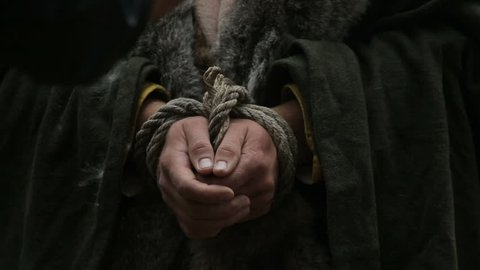 Bound hands of a man. ?aptive viking. The Varyag was taken prisoner. Prisoner with bound hands. The Viking in the trap.
