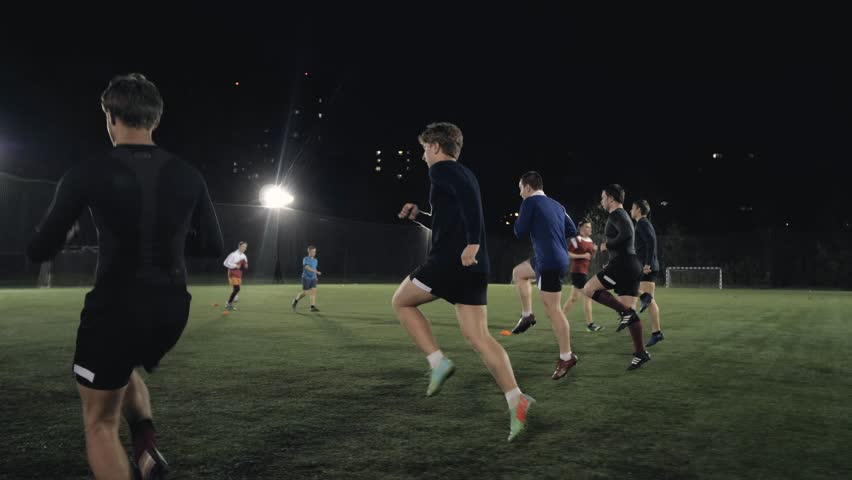 Soccer football players during the team training before the match. Exercises for football soccer youth team. Young player exercises with ball and marker cones, running training rugby men athlete | Shutterstock HD Video #30419866