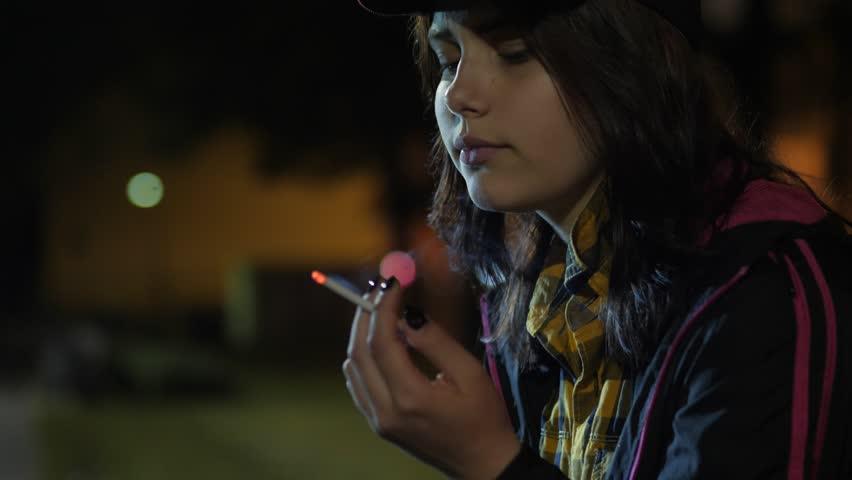 Teen girls smoking cigarettes