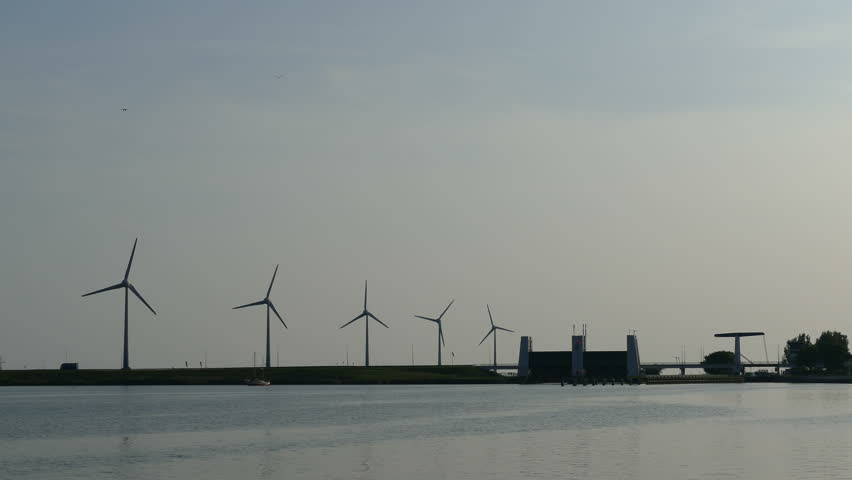 Wind farm at sunset in Ijselmeer at Enkhuizen fishing village
