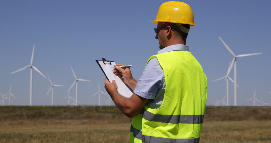 Engineer manager check blueprint technical drawing wind turbine farm engineer man taking notes on clipboard observing supervisor wind turbines motion 4k stock footage clip malvernweather Choice Image