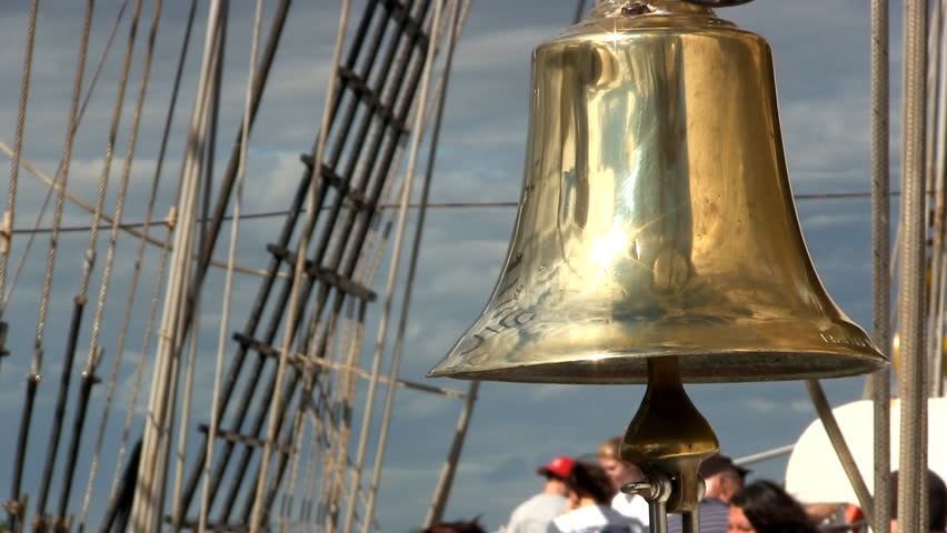 BUZZARDS BAY, CAPE COD. - JULY 26th;  Ships bell hangs quietly as visitors and tourists admire tall ship Dewaruci from Indonesia July 26th, 2012 at Massachusetts Maritime Academy, Buzzards Bay, MA