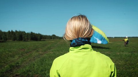Girl and protactive helmet. blonde girl wearing helmet for head protection. Will fly on a paraglider