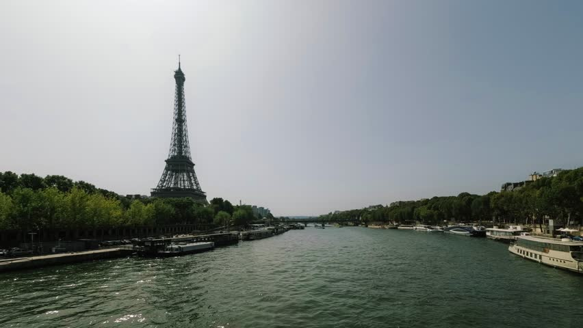 River boats and street traffic time lapse near the Eiffel tower during rush hours in Paris, France. Summer cityscape, city life, vacation and touristic places in Europe. Transport and tourism concept | Shutterstock HD Video #30491281