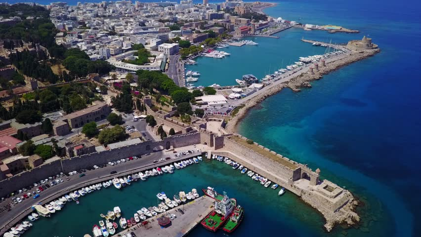August 2017: Aerial drone video of main port near iconic medieval fortified old town of Rodos island, Aegean, Dodecanese, Greece | Shutterstock HD Video #30499762