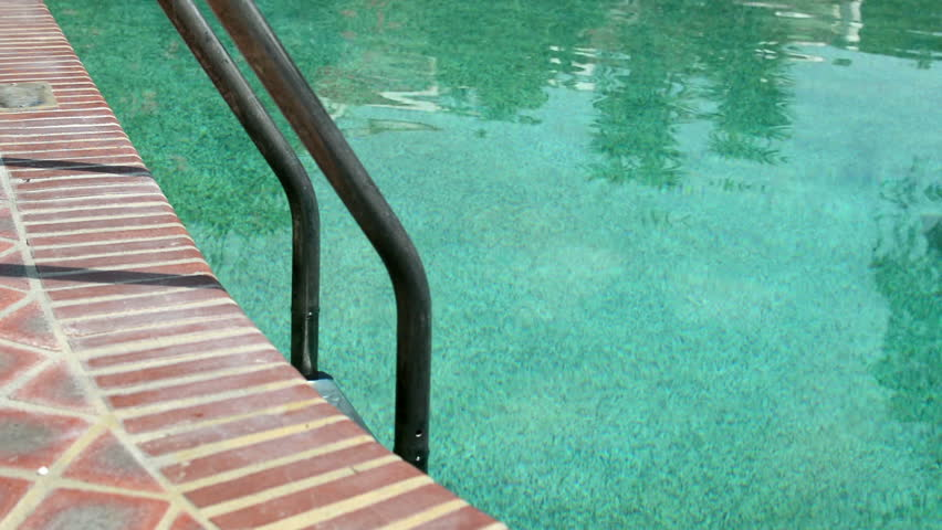 Grab Bars Ladder In Swimming Pool, Outdoors At The Day Time Stock ...