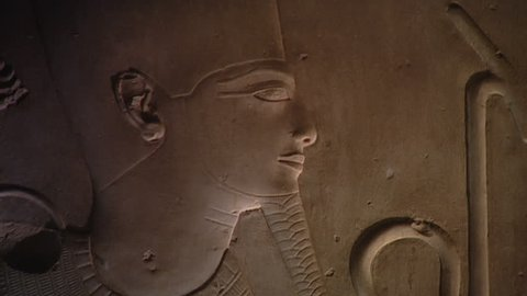 ABYDOS, EGYPT - CIRCA 2002: CU. Raised relief of head of Seti I as Osiris, with pan left to the head of Horus. Unpainted relief from the hypostyle hall (north side), Temple of Abydos.