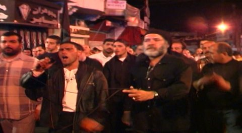 NABATIEH, LEBANON - CIRCA 2005: Ashura. Shia men are beating their chests in ritual mourning. Ashura is the 10th day of Muharram in the Islamic calendar commemorating the death of Hussain Ibn Ali.