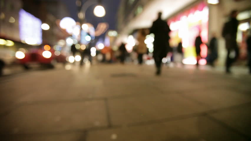 Defocused late night Christmas shoppers, Oxford Street, London, UK.