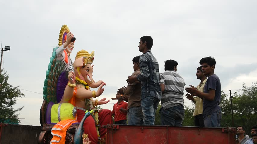 AMRAVATI, MAHARASHTRA, INDIA 5 SEPTEMBER 2017 : Unidentified faithful people perform pray of Hindu God Ganesha before immersion near water bodies, This is an annual festival.   Shutterstock HD Video #30541876
