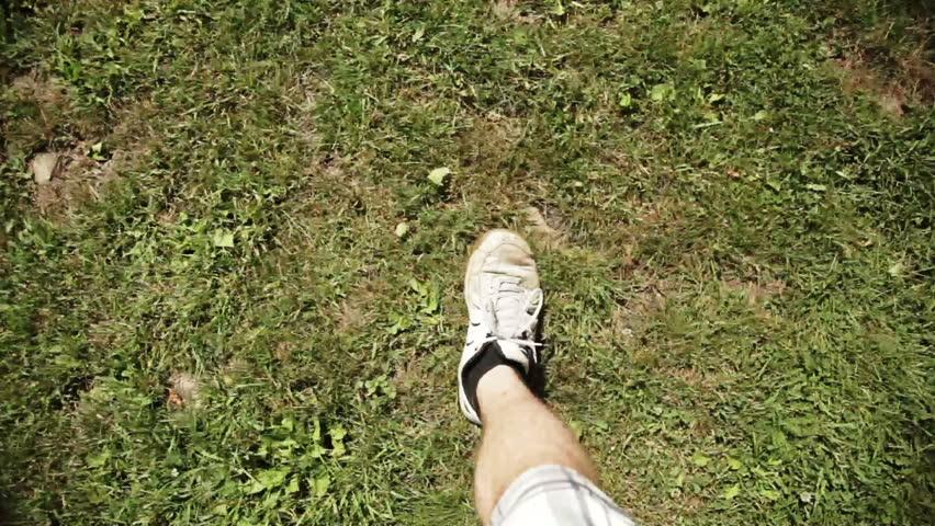 Man Walking on dirt and grass  | Shutterstock HD Video #3054520