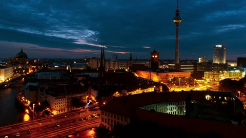 Berlin, Germany. Illuminated landmarks in Berlin, Germany in the morning. Time-lapse of colorful cloudy sky at sunrise