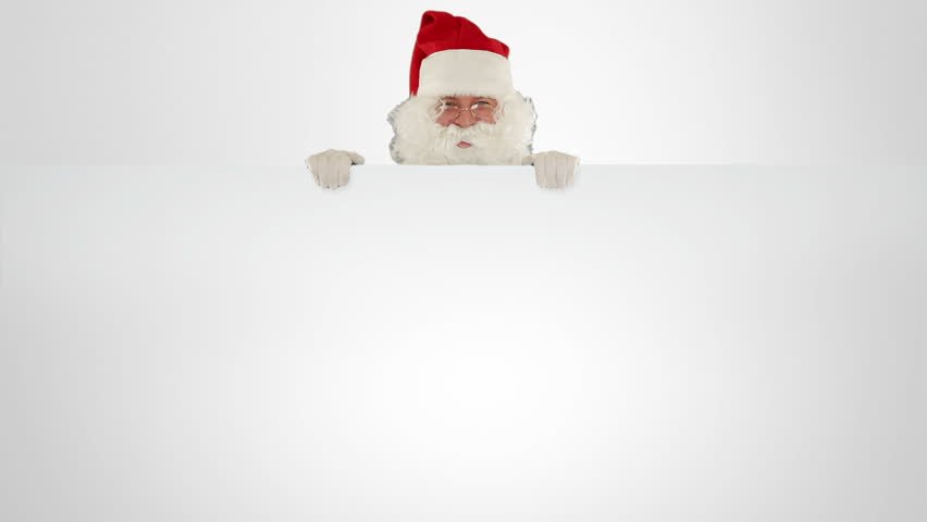 Santa Claus appears behind a white sheet with space for text
