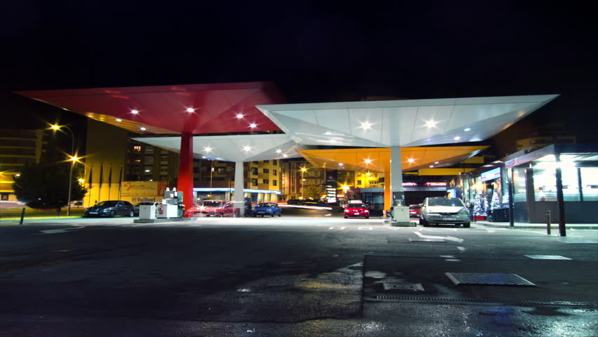 SPAIN - CIRCA 2012: Time lapse of several cars filling fuel at gas station at night circa 2012 in Spain.