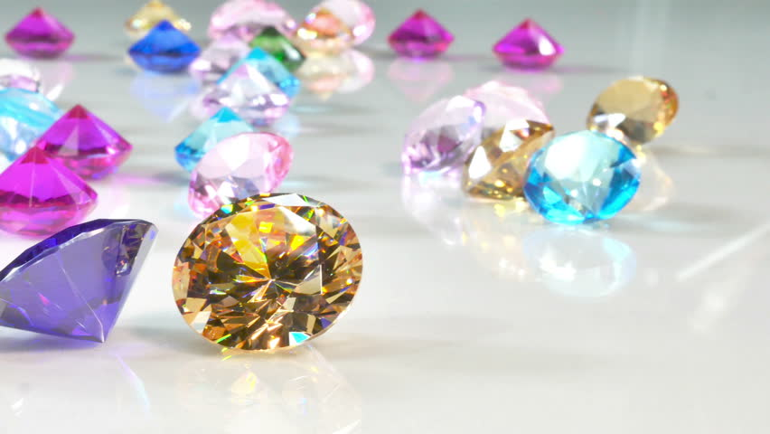 Blue Diamond,tourmaline pink,Amethyst Purple,Citrine Yellow,Iolite smokey blue, Topaz lighter blue,Peridot green,and colorful gems in white background.