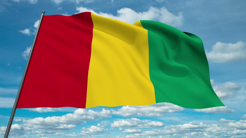 Guinea flag waving against time-lapse clouds background