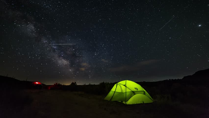 Time lapse of an illuminated tent c&ing under the Milky Way and the night sky. & Camping Under Moving Stars. Night Sky Above Tent. Time Lapse Stock ...