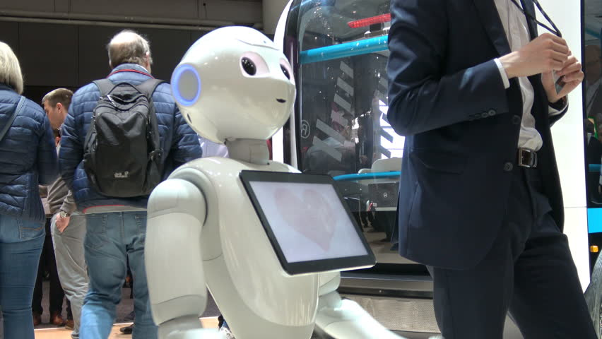 Hannover, Germany - March, 2017: 4K video footage of visitors talking with humanoid robot on exhibition Cebit 2017 in Hannover Messe, Germany | Shutterstock HD Video #30590626