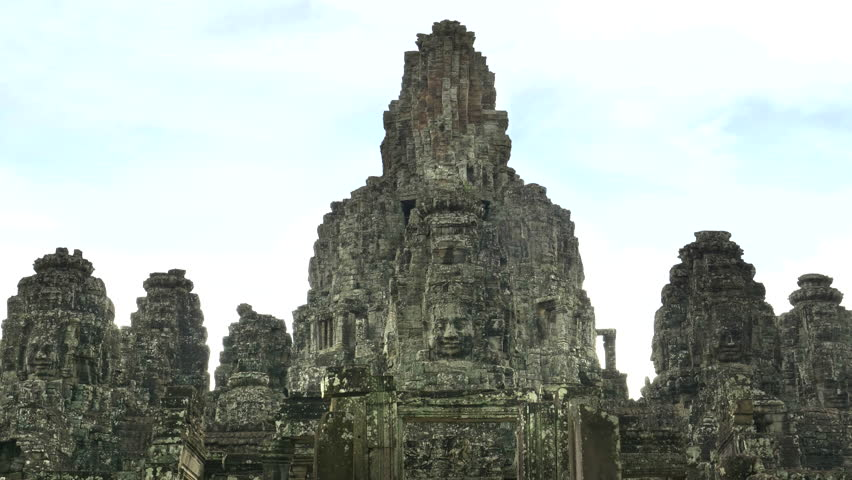 SIEM REAP, CAMBODIA - JUNE, 29 2017: zoom in on a face tower at bayon temple near angkor wat, cambodia #30649696