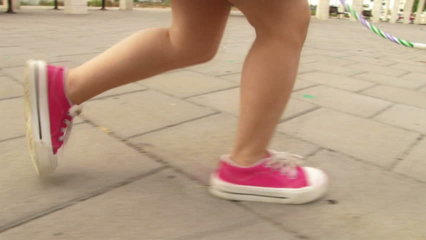 Girl running at playground / park in slow motion
