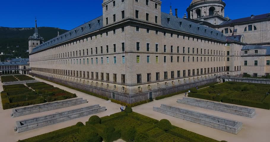 The Royal Seat of San Lorenzo de El Escorial, historical residence of the King of Spain, about 45 kilometers northwest Madrid, in Spain. Amazing aerial view from the top with a wide - 015