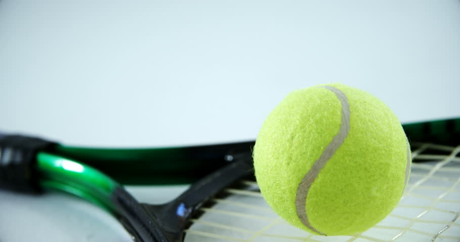 Close-up of racket and tennis ball on white background 4k | Shutterstock HD Video #30697726